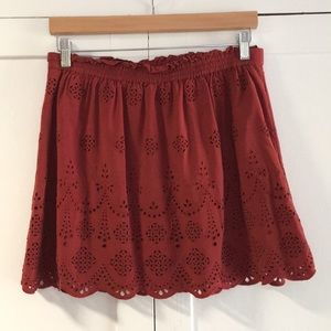 Red skirt with eyelet pattern
